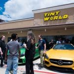 Yellow Benz with People In Front of It